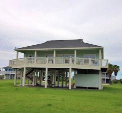 3190 Castle Dr. Sand Castle Beach Subd. Crystal Beach, TX.   3/2/1 on a LARGE lot.  Close to Beach. Deck, Golf Cart Access to Beach.  $245,000